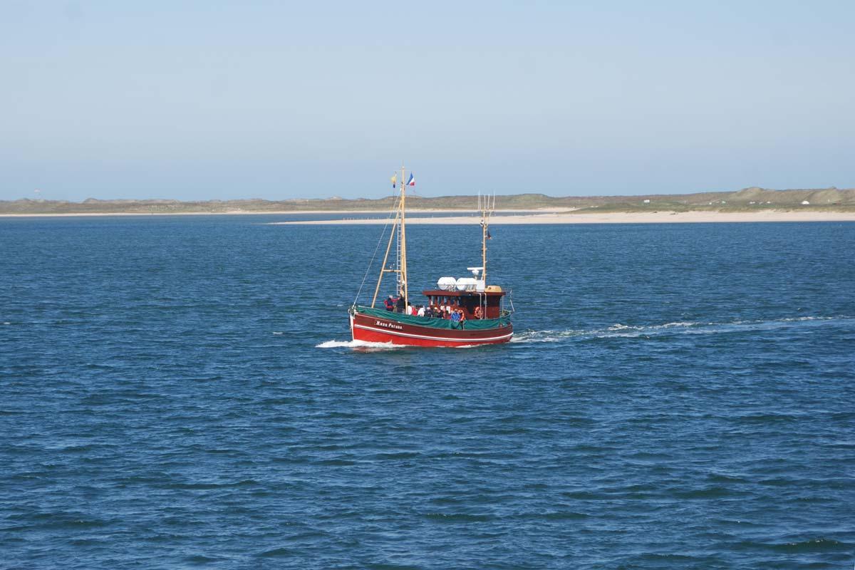 Ausflugsboote vom Lister Hafen garantieren ebenfalls einen traumhaften Blick