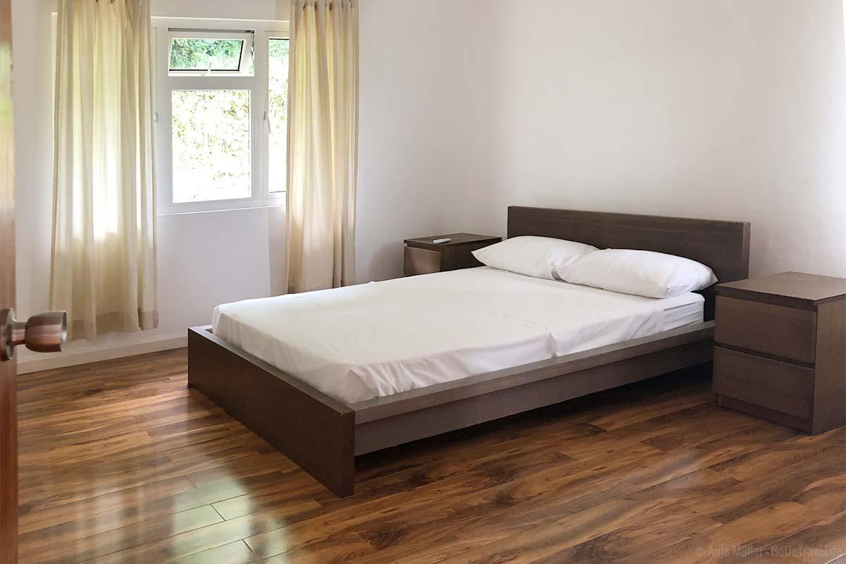 Ein Schlafzimmer in der Küche und Essbereich in der Songbird Villa